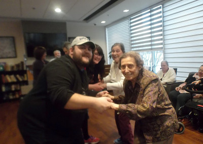 Dancing with our residents at our Channukah Party.