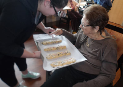 Making Mandelbread cookies during our baking program.