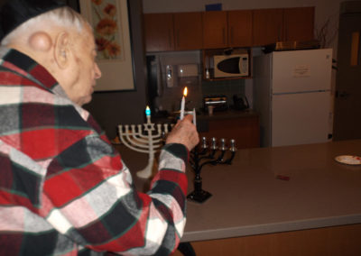 Lighting the Channukah candles.