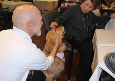Enjoying spending time with our animal therapy team, Bryan and Piper, a Golden Retriever Puppy.