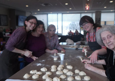 Smiling for the camera during our weekly challah baking program.