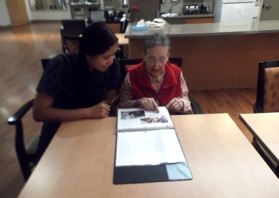 "One of our residents reading our ""Through the Seasons"" book made by programs staff and students."