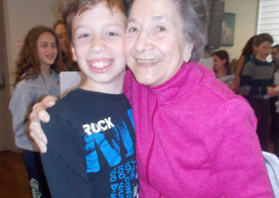 One Of Our Residents Posing With A Student From Leo Baeck's Glee Club That Performed For Us On Feb 3rd.