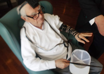 Putting on tefillin during our weekly Friday visits with Rabbi Dov Marshall from Jewish Seniors Circle.