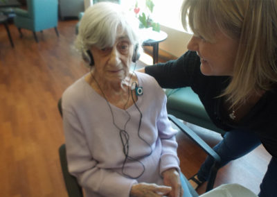 Listening to music on her very own iPod donated by the Alzheimer Society of Toronto's Music Project.