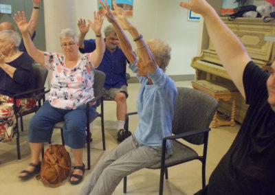 Enjoying a yoga and wellness class given by one of our residents.
