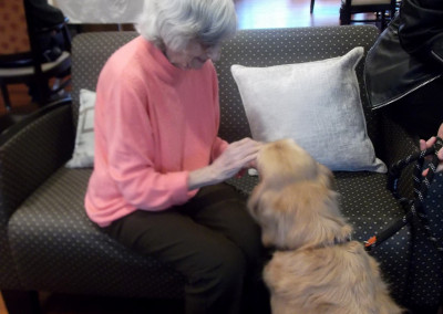 Our residents love our weekly animal therapy visits with Bryan and Piper, an adorable golden retriever.